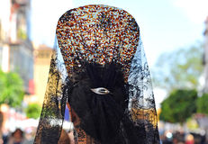 Andalusian woman with mantilla and back comb, Holy Week in Seville, Andalusia, Spain Stock Photography