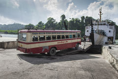 ANDAMAN ISLAND, INDIA - MARCH 18 2016: Shutter bus crossing rive Stock Photo
