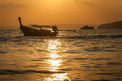 Andaman Sea and longtail boat. Andaman Sea, Thailand,Tropical beach, long tail boats, Thailand,Long tail boats on beach,Andaman Sea,krabi,thailand,sunset,island Royalty Free Stock Photos