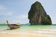 Andaman Sea - Thailand. Long tail boat and limestone rock in the Andaman Sea - Krabi - Thailand Stock Images