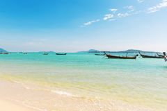 Andaman Sea with traditional Thai long tail boats Stock Photos