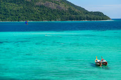 Andaman sea  two deep color sea with long tail boat Royalty Free Stock Images