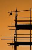 Andamio en la puesta del sol Fotos de archivo libres de regalías