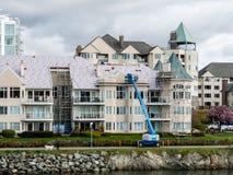 Andelslägenhet under konstruktion på Victoria Harbor, F. KR. Royaltyfri Bild