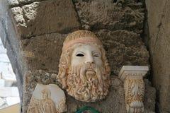 Andenken, die eine griechische Maske darstellt Stockfotos