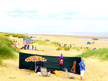 Anderby Creek sands, Lincolnshire. Families enjoying a day in the sand dunes and beach at Anderby Creek, Mablethorpe, Lincolnshire, England, UK Royalty Free Stock Images