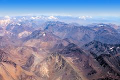 The Andes in Chile. The Andes mountain range view from a plane in landscape format stock photo