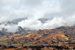 Andes on a cloudy day. Andes Landscape: near Quilotoa, water-filled caldera and the westernmost volcano in the Ecuadorian Andes Stock Photo
