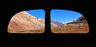 Andes Mountain Rainge View through a window bus. Back window bus view on the Andes Mountains range with a clear blue sky and snowy peaks stock photo