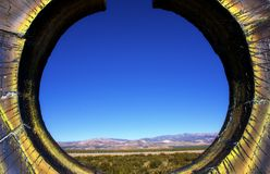 Andes mountain range with colorful round frame. Andes  Mountain range seen through a round hole stock image