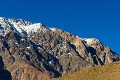 Andes mountain range in Elqui Valley. Snow peaks of Andes mountain range under intense blue sky in Elqui Valley, Chile. Exploration hike, trekking adventure royalty free stock photo