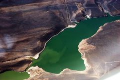Andes Mountains and Lake. An aerial view of the andes mountains and a lake royalty free stock image