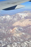 The Andes mountains, the longest continental mountain range in the world, is being seen from a plane view Stock Images