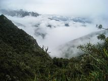 The Andes mountains and low clouds from the Inca Trail. Peru. stock image