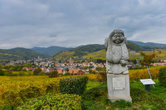 Andlau, Alsace village, vineyard, statue of monk carrying wine barrel Royalty Free Stock Photography