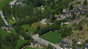 Andorra from above. Smooth camera movement: Tilt down. Panoramic aerial view of the  valley bottom of `Ordino` with green meadows, small villages stock video footage