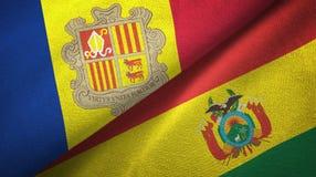 Andorra en Bolivi? twee vlaggen textieldoek, stoffentextuur stock illustratie