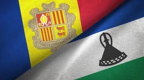 Andorra en Lesotho twee vlaggen textieldoek, stoffentextuur stock illustratie