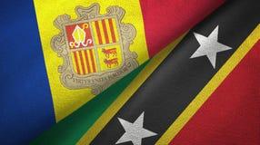Andorra en St.Kitts.en.Nevis twee vlaggen textieldoek, stoffentextuur royalty-vrije illustratie