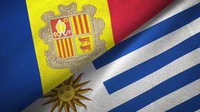 Andorra en Uruguay twee vlaggen textieldoek, stoffentextuur stock illustratie