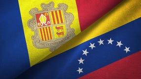 Andorra en Venezuela twee vlaggen textieldoek, stoffentextuur royalty-vrije illustratie