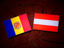 Andorra flag with Austrian flag on a tree stump  Stock Images