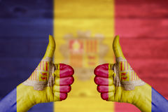 Andorra flag painted on female hands thumbs up Royalty Free Stock Images