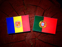 Andorra flag with Portuguese flag on a tree stump isolated. Andorra flag with Portuguese flag on a tree stump vector illustration