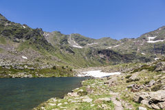 Andorra in July. A lake and snow in the Pyrenees in July Royalty Free Stock Images