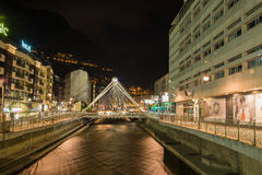 Andorra la Vella city night view. The capital of Andorra, Andorra la Vella with the Valira river crossing the city and the illuminated bridge and night life of stock images