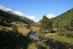 Andorra between mountains with a small creek royalty free stock photos