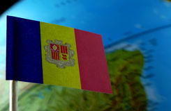 Andorran flag with a globe map as a background Royalty Free Stock Images