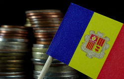 Andorran flag waving with stack of money coins Stock Photos