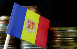 Andorran flag waving with stack of money coins Royalty Free Stock Photography