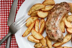 Andouillette with french fries royalty free stock photography