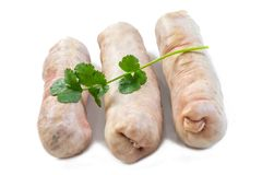 Andouillette: Salchicha típica francesa del intestino del cerdo en un fondo blanco fotografía de archivo