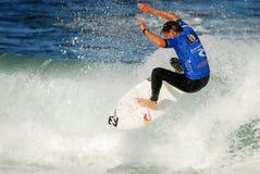 Andrés plancha el Rip Curl que practica surf competencia Foto de archivo libre de regalías