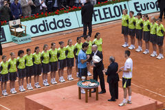 Andre Agassi cup delivers to Roger Federer of Sw. PARIS - JUNE 7: Andre Agassi cup delivers to Roger Federer of Switzerland for victory in man's single category Stock Photo