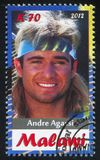 Andre Agassi. Malawi - CIRCA 2012: stamp printed by Malawi, shows Andre Agassi, circa 2012 Royalty Free Stock Photo