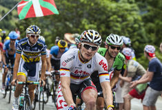 Andre Greipel Climbing Alpe D'Huez. Alpe-D'Huez,France- July 18, 2013: The German cyclist Andre Greipel from Lotto Belisol Team climbing the difficult road to Royalty Free Stock Images