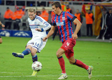 Andre Schurrle of Chelsea and Lukasz Szukala of Steaua Royalty Free Stock Photos