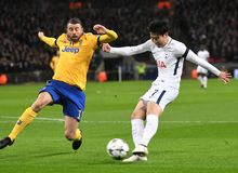 Andrea Barzagli and Heung-Min Son. Players pictured during the UEFA Champions League Round of 16 game between Tottenham Hotspur and Juventus Torino held on March Royalty Free Stock Image