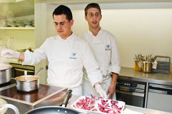 Andrea Canton's sous chefs cooking Royalty Free Stock Photo