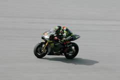 Andrea Dovizioso of Monster Yamaha Tech 3. SEPANG, MALAYSIA-MAR 01: Andrea Dovizioso of Monster Yamaha Tech 3 accelerates after turn 14 during the 2nd MotoGP Royalty Free Stock Image