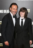 Andrew Lincoln, Chandler Riggs. NEW YORK-OCT 9: (L-R) Actors Andrew Lincoln and Chandler Riggs attend AMC's 'The Walking Dead' season six premiere at Madison Royalty Free Stock Image