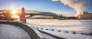 Andrew's bridge. Across the Moscow River in the ice snowy floes and winter sun Royalty Free Stock Photo