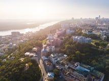 Andrew`s Descent old street. Panaramic aerial drone sunrise view. Historical center. Lovely Kiev Ukraine. Sunrise soft. Backlight. River Dnepr Dnipro royalty free stock photos