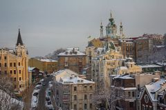 Andrew`s Descent and St. Andrew`s Church in winter weather. Ukraine stock photo