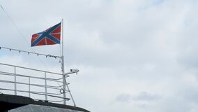 Andreyevsky Naval Flag on a submarine. Submarine on the surface of the water with the flag of the Russian Federation.