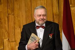 Andris Vilks, director of LNB with received book from President stock photo